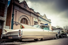 1960 Cadillac sittin low in the street