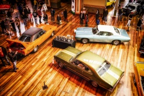 Muscle cars surround the trophies for presentation purposes