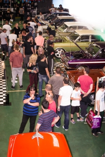 Eager crowds mill around elite cars on show