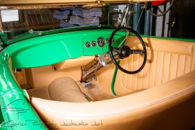 The tan leather interior contrasts nicely with the HOK green hue